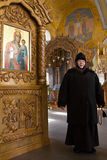 Kazan, Russia, 9 february 2017, golden domes in Zilant monastery - - a nun - Mother Sergiya in orthodox church near. Icons, vertical Royalty Free Stock Photo