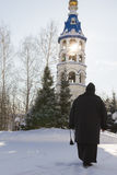 Kazan, Russia, 9 february 2017, golden domes in Zilant monastery - oldest orthodox building - a nun holds a rosary in. His hands near bell tower, vertical Royalty Free Stock Photos