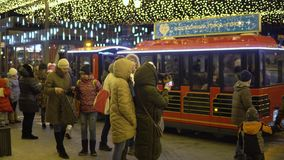 KAZAN, RUSSIA - JANUARY, 2018: children`s steam locomotive on the New Year`s Street rolls kids. Children`s steam locomotive on the New Year`s Street rolls kids stock video