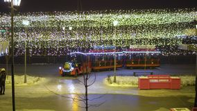 KAZAN, RUSSIA - JANUARY, 2018: children`s steam locomotive on the New Year`s Street rolls kids. Children`s steam locomotive on the New Year`s Street rolls kids stock video footage