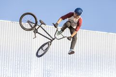 Kazan, Russia - July 11, 2021: The cyclist performs skills on Pump-track at the Uram Park in Kazan