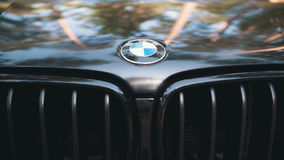 Kazan, RUSSIA july 2017: the hood of the automobile BMW with sign logo on black car - popular luxury sport car. Close up Stock Images
