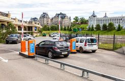 Automatic rising arm barrier for entry or stop traffic. Kazan, Russia - June 12, 2018: Automatic rising arm barrier for entry or stop traffic at the car parking stock photo