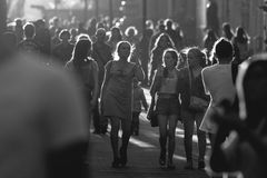 KAZAN, RUSSIA - JUNE 21, 2018: Black and white crowd of people walking down the main pedestrian street Bauman. Telephoto shot Royalty Free Stock Photos