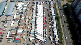 Top view of the car market. shooting with copter. Kazan, Russia - 08.04.2018: The largest food market in the city of Kazan. Here are sold fruits and vegetables stock video footage