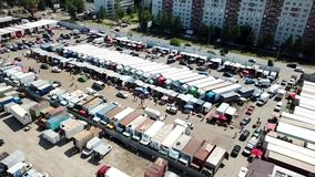 Top view of the car market. shooting with copter. Kazan, Russia - 08.04.2018: The largest food market in the city of Kazan. Here are sold fruits and vegetables stock footage