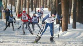 KAZAN, RUSSIA - MARCH, 2018: children skiers running on ski-track on ski marathon. Slow motion stock footage
