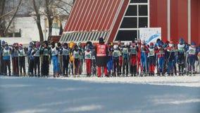 KAZAN, RUSSIA - MARCH, 2018: Many of children skiers waiting for start cross-country skiing. KAZAN, RUSSIA - MARCH, 2018: Many of children skiers waiting for stock footage