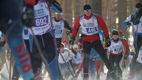 Kazan, Russia - March, 2018: Men skiers running ski marathon, big group at the start of the race. Winter sports and competition concept stock video footage