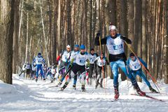 KAZAN, RUSSIA - March, 2018: professional sportsmen -athletes skiers running ski marathon. Winter sports and competition concept Royalty Free Stock Photography