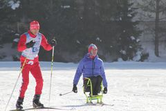 KAZAN, RUSSIA - MARCH, 2018: The skier and disabled skier on ski-track on city competitions cross-country skiing royalty free stock photography