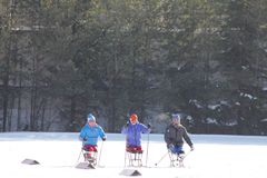 KAZAN, RUSSIA - MARCH, 2018: Three disabled skiers waiting to start on city ski competitions. In sunny day stock photo
