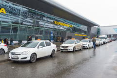Kazan, Russia - March 25.2017. White taxis near the airport terminal 1A. Kazan, Russia - March 25.2017. The White taxis near the airport terminal 1A Stock Photos