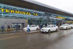 Kazan, Russia - March 25.2017. White taxis near the airport terminal 1A. Kazan, Russia - March 25.2017. The White taxis near the airport terminal 1A Royalty Free Stock Photography