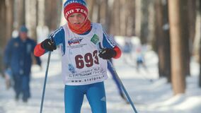 KAZAN, RUSSIA - MARCH, 2018: Young boy skier running on ski-track on cross-country skiing in sunny day. KAZAN, RUSSIA - MARCH, 2018: Young boy skier running on stock video