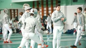 Kazan, Russia - 26 March, 2018: Young fencers fighting on the fencing tournament. Kazan, Russia - 26 March, 2018: Young fencers fighting with the rapiers on the stock video footage