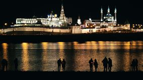 Kazan, Russia, 12 may 2017 - Festival of floating Lanterns on Kazanka - silhouette of people in front of kremlin stock video footage