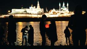 Kazan, Russia, 12 may 2017 - silhouette loving couple at festival of floating Lanterns on Kazanka stock video footage