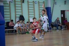 Children play basketball. KAZAN, RUSSIA, NOVEMBER, 10 2016 Children play basketball royalty free stock photos