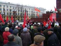 Kazan, Russia - November 7, 2009: Communist party demonstration. People listen to the leader near the Lenin's monument - Royalty Free Stock Photography