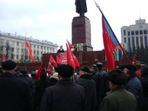 Kazan, Russia - November 7, 2009: Communist party demonstration. People listen to the leader near the Lenin's monument Stock Images