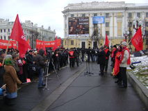 Kazan, Russia - November 7, 2009: Communist party demonstration. several People listen to the leader near the Lenin's stock photo