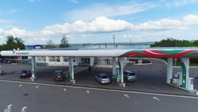 Man Arrives in Car to Fuel Station to Fill Tank Aerial View. KAZAN, TATARSTAN/RUSSIA - AUGUST 25 2017: Aerial view man arrives in car to fuel station to fill stock video footage