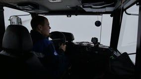 Closeup Man in Cabin Drives Car along Road Turns Right. KAZAN, TATARSTAN/RUSSIA - DECEMBER 20 2016: Closeup backside view man in cabin drives car along road and stock video