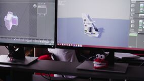 Man works with 3d-models on computer in company office