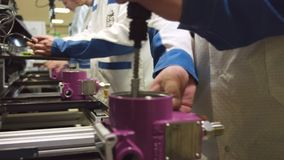 Meter production line and workers assemble devices