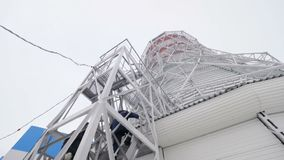 Workers step up stairs on cooling tower platform
