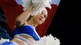 Slow motion pretty girl cheerleader dances at waving club flag. KAZAN, TATARSTAN RUSSIA - JUNE 28 2018: Slow motion pretty slim girl cheerleader dances against stock video