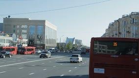 Slow Motion Vehicles Drive along Road Past City Hotel. KAZAN, TATARSTAN/RUSSIA - SEPTEMBER 19 2017: Slow motion vehicles drive along wide asphalt road on stock footage