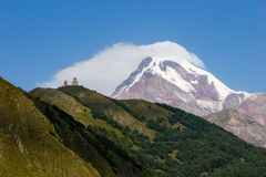Kazbeg. The top of Kazbeg in Georgia. Near to Russian Federation Stock Images