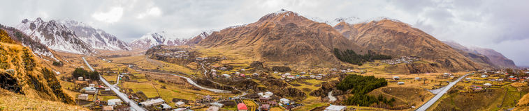 Between Kazbegi and Gudauri I. A panorama picture of the mountainous scenery between Kazbegi and Gudairi shot from the Sioni Cathedral Royalty Free Stock Photography