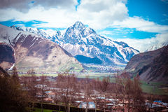 Kazbegi. Spring view of Caucasus mountains near Kazbek (Kazbegi) mountain, Georgia Stock Image