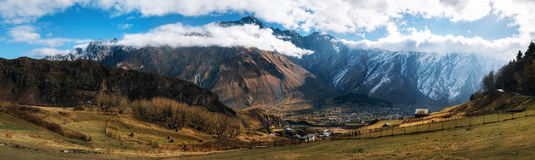 Kazbegi Stepantsminda And Gergeti Against Caucasus Mountains. Georgia. Stock Image