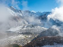 Kazbegi village in the snowy mountains of Georgia. Panorama. Top view stock images