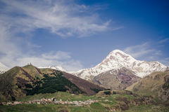 Kazbek mountain and Gergeti Trinity Church Royalty Free Stock Photo