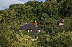 Kazimierz Dolny, Poland - houses in the forest. This image shows a view of Kazimierz Dolny, a small town in Poland, Europe. It was taken in June 2017 on a Stock Image