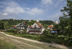 Kazimierz Dolny, Poland - houses in the green. This image shows a view of Kazimierz Dolny, a small town in Poland, Europe. It was taken in June 2017 on a Royalty Free Stock Images