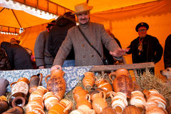 Kaziuko fair. VILNIUS, LITHUANIA - MARCH 7: A man sells hollowware during the annual traditional crafts fair - Kaziuko fair on Mar 7, 2009 Stock Photography