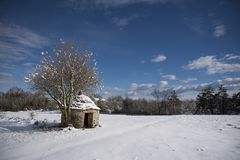Kazun, a traditional drywall shelter under the snow Stock Photo