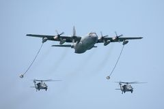 KC-130 tactical tanker with two helicopters stock image