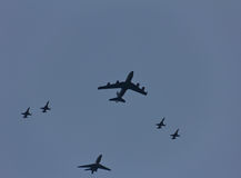 KC-135 tanker in formation with F16 Stock Images