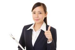 kciuki w górę uśmiechnięta kobieta jednostek gospodarczych Obrazy Stock