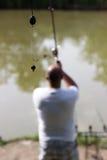KD Rig, Blurred fisherman casting, Carp Bait, Boili Hair, Blow Back Rig, Carp Hook stock images