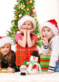 Kds sit beside Christmas presents Stock Photography