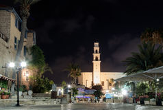 Kdumim square and St. Peter`s Church with the Clock Tower at night in old city Yafo, Israel. stock photo