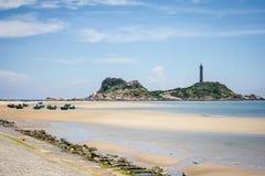 Ke Ga灯塔和越南小船在背景中 图库摄影